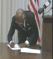 Charlie Dooley signing bill