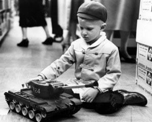 David Kothe, 4, son of Mr. and Mrs. David Kothe of Florissant, imagines himself commander of a toy tank at the Stix, Baer & Fuller store in November 1958. Jack January/Post-Dispatch